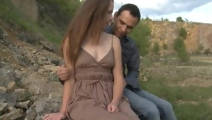 In force Age Teenager whore copulates with her partner outdoors on a massive stone