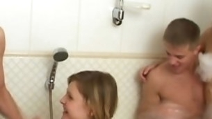 Two horny legal age teenager couples are having unforgettable foursome fucking in a bathroom